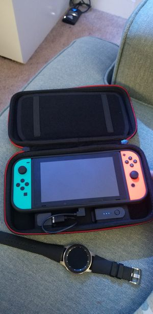 Nintendo switch. With case and charging carrier case. Come with pokemon eevee and super smash. for Sale in Pemberton, NJ