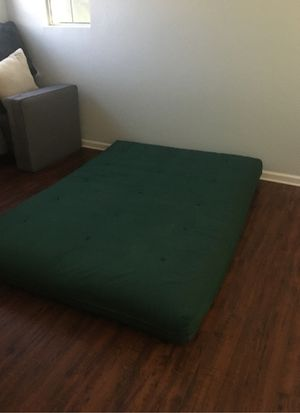 Nice clean futon with cover and two matching pillows for Sale in Fort McDowell, AZ
