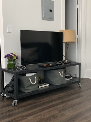 CB2 go-cart black rolling media media console / coffee table for Sale in San Francisco, CA