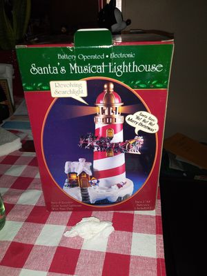 Christmas thing santa musical lighthouse new in box n i have not in box 15.00 for the one n 10.00 the not in box for Sale in Stockton, CA