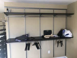 Elfa Walnut wall closet shelf and rack system for Sale in Indianapolis, IN