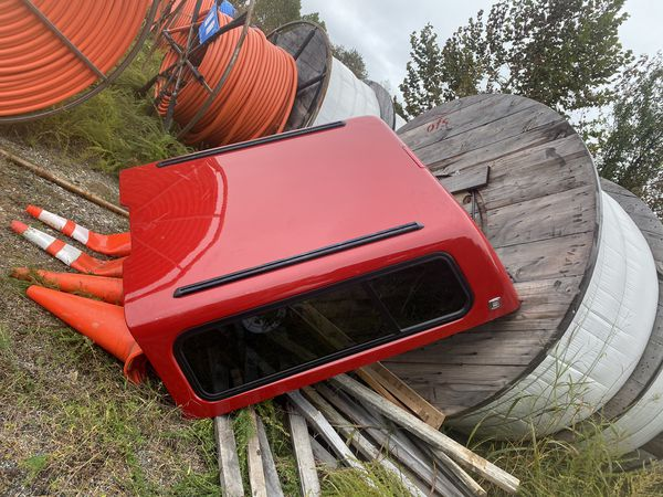 """Century short bed fiberglass truck topper. Has been kept in pristine condition. Was recently transported and one side got scratched up. 76"""" z 70"""""""