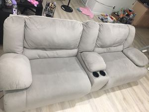 Power Reclining Sofa Couch w/removable cup holder centerpiece for Sale in Fairfax, VA