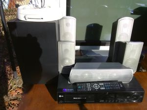 500 Watts LG surround sound receiver with built-in 5 discs DVD player with remote control plus speakers for Sale in Washington, DC