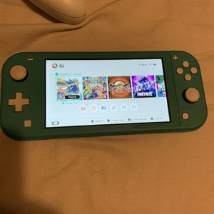Nintendo Switch Lite with Case and Games for Sale in Baton Rouge, LA