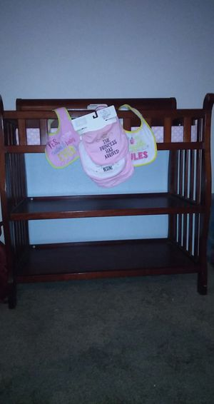 Cherry oak changing table and baby clothes for Sale in Phoenix, AZ