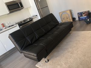 Stylish black leather couch/futon. Great for small apartments or bedrooms. for Sale in Los Angeles, CA