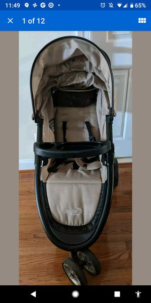 Baby Jogger City Lite Stroller with child tray, parent tray, weather shield for Sale in South Riding, VA