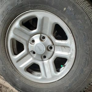 2 Jeep tires and rims for Sale in Seabrook Island, SC