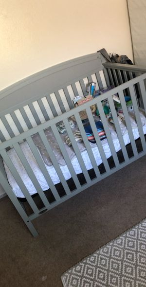 Matching gray crib and changing table for Sale in Stockton, CA