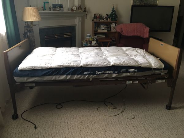 Mechanical/electric twin size hospital bed.