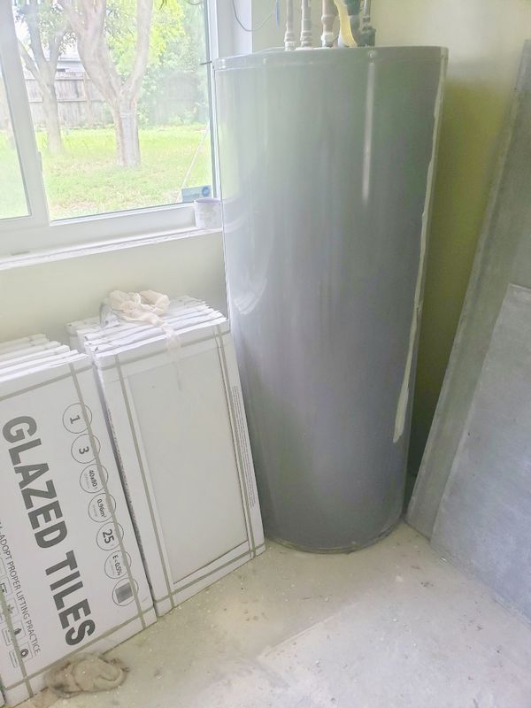 WATER HEATER with SOLAR PANEL (LIKE NEW!)