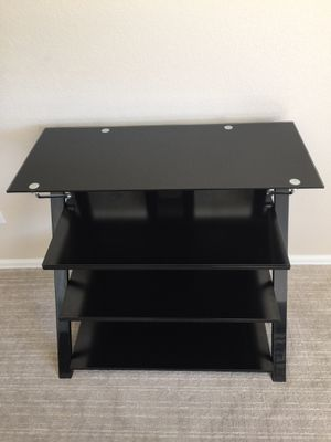 Black tempered glass entertainment stand for Sale in Denver, CO