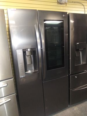 "LG 36""wide new scratch and dent side by side dark stainless steel refrigerator 6months warranty for Sale in McDonogh, MD"