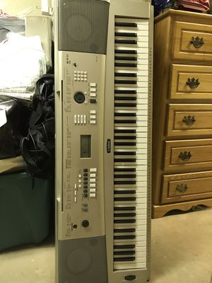 Yahama keyboard, music rack, and sustain pedal. Piano has tons of features. Keys are not weighted. for Sale in St. Louis, MO