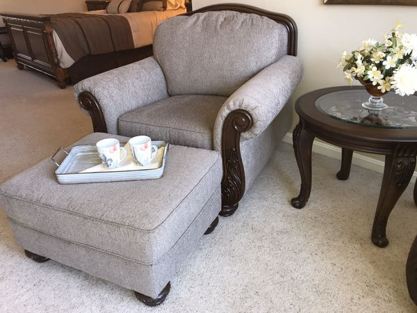 Pair of overstuffed lounge chairs, ottoman, and round table