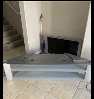 Glass tv stand for Sale in Las Vegas, NV