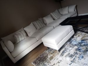 Beautiful brand new sectional and a coffee table and ottoman for Sale in Sandy, UT