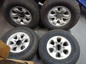 aluminum Mitsubishi Montero rims and good tires 6 lug fits others for Sale in Montebello, CA