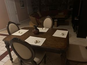 Beautiful oak table with four chairs and middle extension. for Sale in Stockbridge, GA