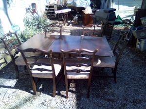 Duncan Hines table and made in the early fifties got the brass claw Ann's on the leg nice antique table with 6 matching chairs$350chairs six chairs for Sale in Nashville, TN