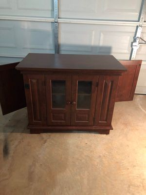 Glass front cabinet with end storage for Sale in Hiram, GA