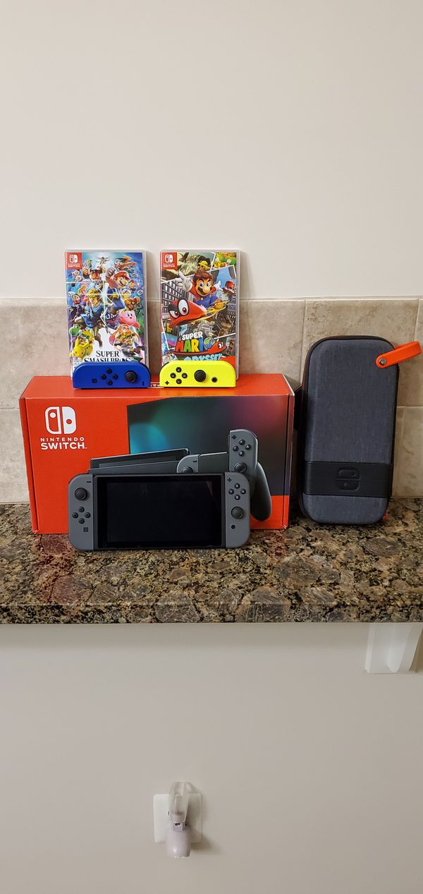 Nintendo switch with 2 games and extra joycons
