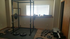 Black power rack and weights for Sale in Parker, CO
