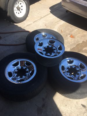 Chevrolet /GM 8 lug set of 4 chrome rims 16 in tires would need replacement sorry lost caps for Sale in Fontana, CA
