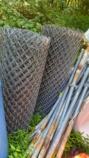 Two rolls of fencing with a bunch of polls and five poles that are over 20 foot for Sale in Middletown, PA