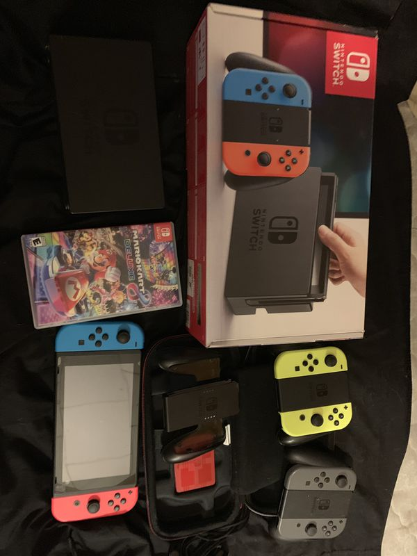 Nintendo switch with Mario kart and 3 controller (2 play and charge) all cords and original packaging