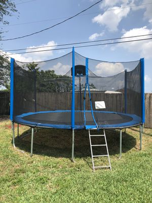 Trampoline with safety net and basketball hoop for Sale in Davie, FL