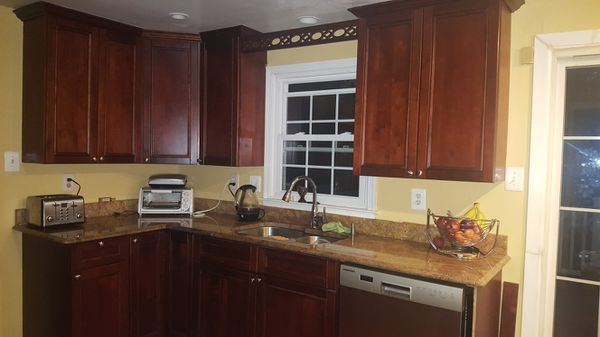 Full set of Kitchen cabinets with counter top.