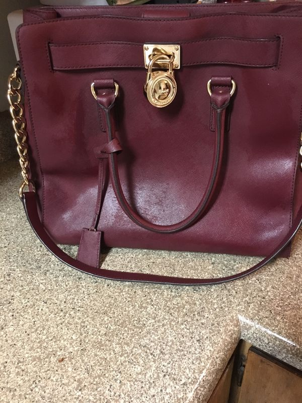 MK handbag limit edition I spent $450 I'm trying to get $200 for it best offer I only wore it twice nothing's wrong with it no rips or anything still