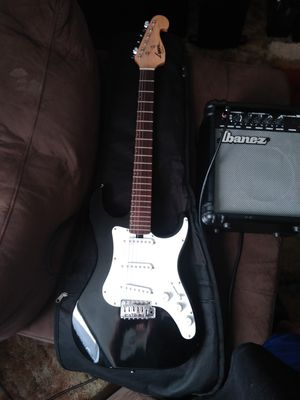 Washburn lyon strat. Missing high E string but plays and sound really good. for Sale in St. Helens, OR