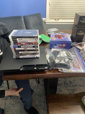 Ps3 slim 2 remotes 10 games for Sale in Dearborn, MI