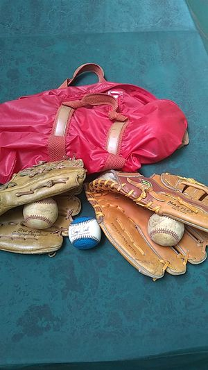 2 Baseball gloves and 3 baseballs for Sale in Bowie, MD