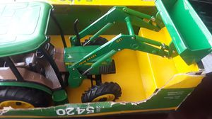 Two John Deere- Ertl5420 & another one which I couldn't locate the model #. The one with the box sells for $69.95. The other tractor in older for Sale in St. Cloud, FL