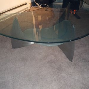Nike shaped glass coffee table two level for Sale in Portland, OR