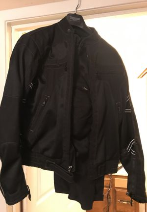 Triumph motorcycle suit and padding for Sale in Aubrey, TX