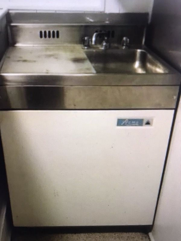 Antique ACME refrigerator freezer with sink