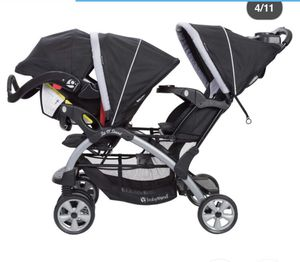 Graco twin stroller with one car seat and base for Sale in Apex, NC
