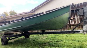Aluminum boat had for years boat is good to go no holes no leaks comes with motor for Sale in Moreno Valley, CA
