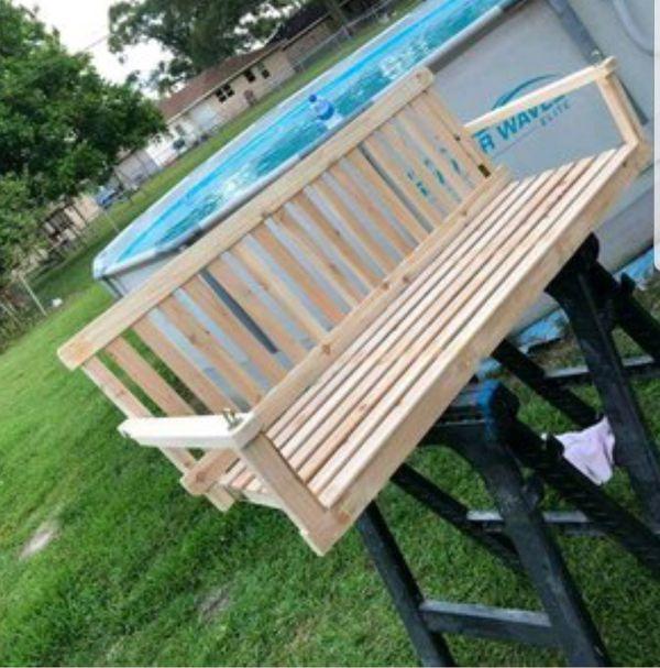 Handmade wood porch swing