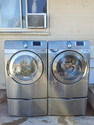 Stainless steel samsung electric steam washer and steam dryer for Sale in Peoria, AZ