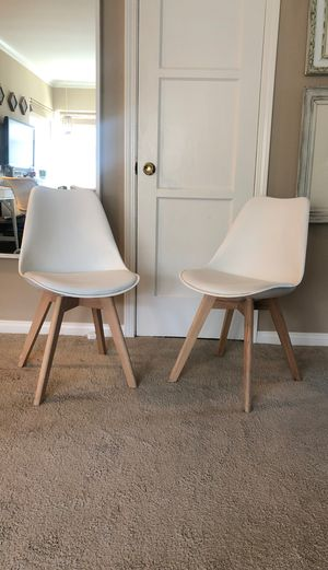 Pair of mid century modern dining chairs with white leather seat for Sale in Los Angeles, CA