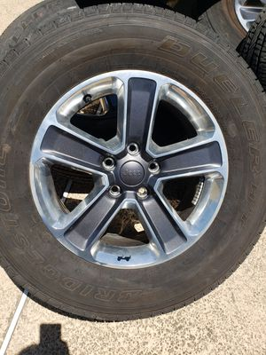 Jeep wrangler sahara Rubicon gladiator oem 18s 5x5 aka 5x127 wheels and tires for Sale in Duncanville, TX