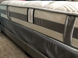 **King Koil **Queen size bed 2yrs old VERY CLEAN LIKE NEW Bed frame included with waterproof mattress cover. for Sale in New Richmond, WI