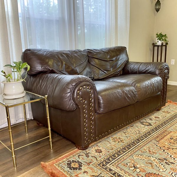 Genuine Leather Brown Loveseat With Brass Studs FREE DELIVERY (PENDING SALE )