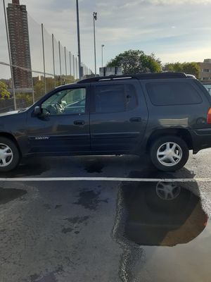 2005 GMC Envoy ,needs fuel sending unit, damage to left headlight and bumper, 207000 miles, older truck needs work but runs from ct to ny everyday for Sale in New Haven, CT